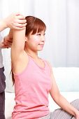 stock photo of chiropractic  - woman getting chiropractic at the health spa - JPG