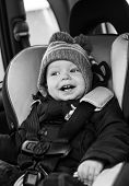 Happy Little Boy In Car Seat