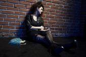 foto of hooker  - portrait of girl dressed like hooker posing near brick wall - JPG