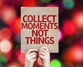 Collect Moments Not Things written on colorful background with defocused lights