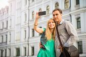 Vacations, dating and tourism concept middle aged couple with camera and city map. Happy tourists si