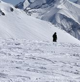 Ski Trail And Snowboarder In Sun Winter Day