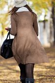 Portrait Of Beautiful Girl Walking In Autumn.