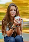 Beautiful girl with cup