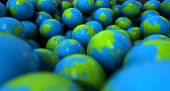 picture of gumballs  - An extreme closeup concept of a collection of gumballs resembling little earth globes - JPG