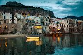 stock photo of beach-house  - harbor view of old houses in Cefalu at dusk Sicily - JPG