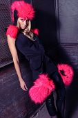 Strong Fashion Woman In Black Dress With Pink Cap And Gloves