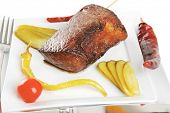grilled meat chunk with vegetables on white plate