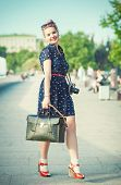 Beautiful Woman In Fifties Style With Braces Holding Retro Camera
