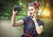 Beautiful Woman In Fifties Style Taking Picture Of Herself