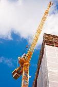 Construction Crane Besides A Building