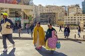 LA PAZ, BOLIVIA, MAY 8, 2014:  Local women in traditional attire walk at Plaza San Francisco
