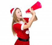 Christmas girl shout with megaphone