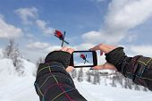 Photographed Skiers Jump With Smart Phone