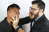 two young businessmen fighting