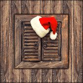 Santa Claus Hat Over Wooden Background. Vintage Style Toned Picture