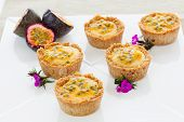 stock photo of passion fruit  - Vegan raw tropical cupcakes with passion fruit