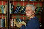 Handsome retired man reading