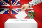 Voting Concept - Ballot Box With National Flag On Background - Manitoba