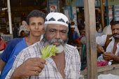 Unidentified man sells khat (Catha edulis) at the local market in Lahij, Yemen.