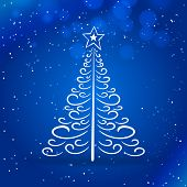 thin Christmas tree with bright blue night background