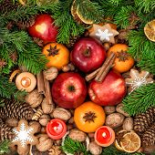 Christmas Decoration With Candles. Fruits, Nuts, Spices And Cookies