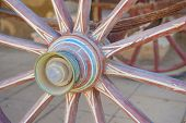 image of carriage horse  - Closeup detail of wheel on old vintage horse drawn carriage - JPG