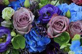 picture of centerpiece  - Blue hydragea and purple roses in a blue purple wedding bouquet and centerpieces - JPG