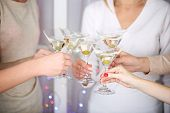 Woman hands with glasses of alcohol