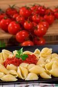 stock photo of italian parsley  - italian pasta with fresh tomato sauce and parsley on black dish - JPG
