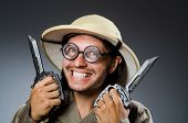 Funny safari hunter against background