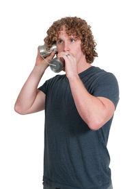 image of tin man  - Young man using tin can phone technology - JPG