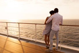 foto of hug  - back view of young couple hugging at sunset on cruise ship - JPG