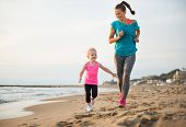 pic of mother baby nature  - Healthy mother and baby girl running on beach