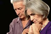 pic of elderly couple  - Sad elderly couple on a black background - JPG