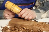 pic of carpentry  - Young craftsman in uniform working at carpentry - JPG