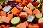 picture of butternut  - Chopped vegetables as an abstract background - red onion sweet potato courgette green pepper red pepper parsnip and butternut squash