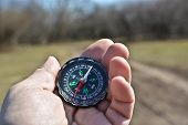picture of compasses  - Compass in the hand on a walk - JPG