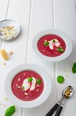 picture of beet  - Soup from beet with light creame nuts and basil sprinkled organic beet - JPG