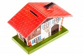 image of plastic money  - a plastic rural toy house money box isolated over a white background - JPG