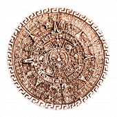 picture of cultural artifacts  - stone maya calendar coaster souvenir from mexico isolated over a white background - JPG