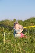 pic of caught  - Laughing cute little boy sitting on grass caught butterfly net - JPG