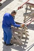 stock photo of air paint gun  - Photo of the Paint worker painting metal designs - JPG