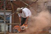 Man Cutting Brick