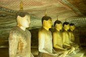 image of cave  - Insides of caves in ancient Buddhist complex in Dambulla cave temple - JPG