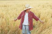 image of oats  - Portrait of teenage farm boy in red checkered shirt and yellow wide - JPG