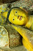 stock photo of cave  - Insides of caves in ancient Buddhist complex in Dambulla cave temple - JPG