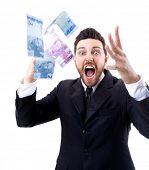 stock photo of brazilian money  - Happy young man in a rain of Brazilian Money - JPG