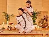picture of thai massage  - Young woman getting thai herbal massage ball - JPG