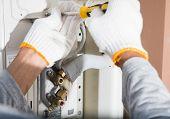 image of air conditioner  - preparing to install new air conditioner and wear gloves - JPG